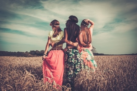 32489241 - multi-ethnic hippie girls  in a wheat field